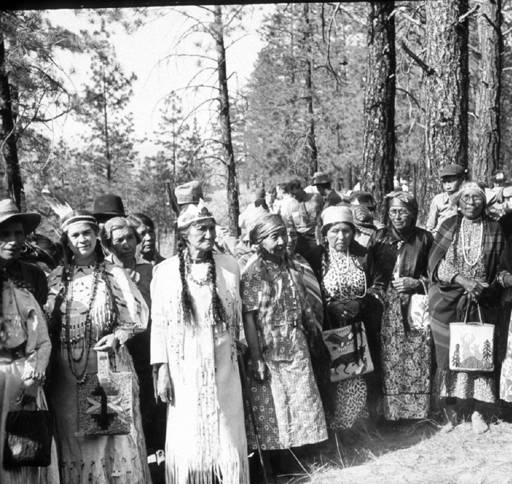 "Kettle Falls, Ceremony of Tears. Colville Tribal women in ceremonial dress, gathered for the Ceremony of Tears. In June 1940, an estimated 8,000 to 10,000 people mourned the drowning of Kettle Falls at a ""Ceremony of Tears"" organized by the Colville Confederated Tribes and attended by representatives of the Yakama, Spokane, Nez Perce, Salish, Kootenai, Blackfeet, Coeur d'Alene, Tulalip, Pend Oreille, and other tribes. Kettle Falls slipped beneath the rising waters of Lake Roosevelt on July 5, 1941. (Northwest Museum of Arts & Culture photo)"